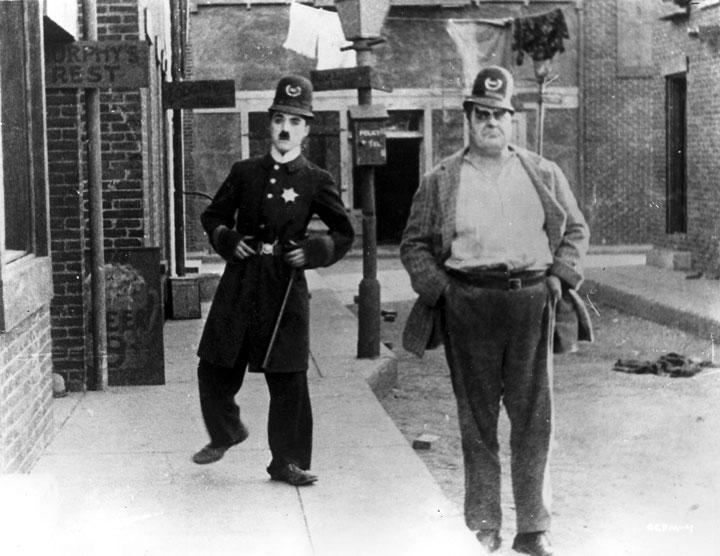 Charlie Chaplin in Easy Street (1917)