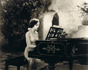 Greta Garbo plays piano