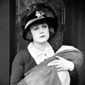 Edna Purviance in The Kid