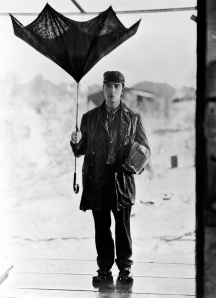 Buster Keaton prepares for the London weather