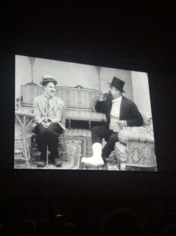 The Cure: Charlie Chaplin and Eric Campbell on the big screen in Piazza Maggiore, Bologna
