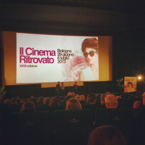 Waiting for a screening to begin at Cinema Arlecchino in Bologna.
