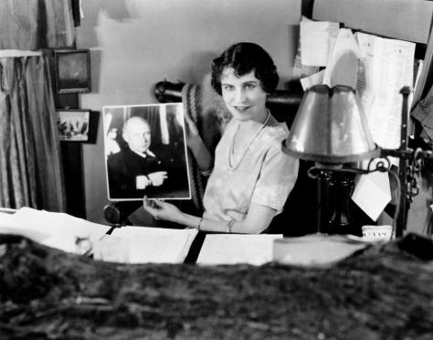 Jeanie Macpherson with a photograph of Cecil B DeMIlle