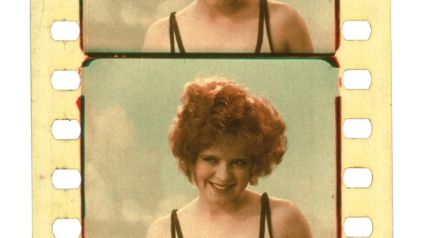 Clara Bow, with her red hair on show