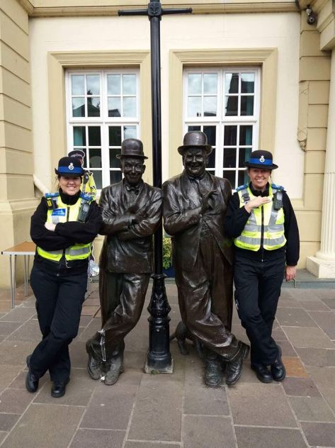 Police in Ulverston posing with the unveiled Laurel and Hardy statue